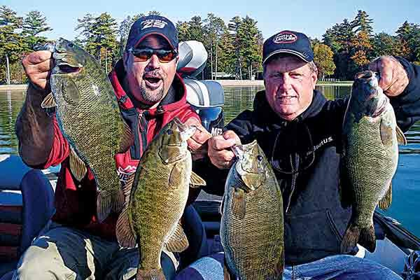 Photo of Mark Zona and Rick Cark with largemouth bass catch