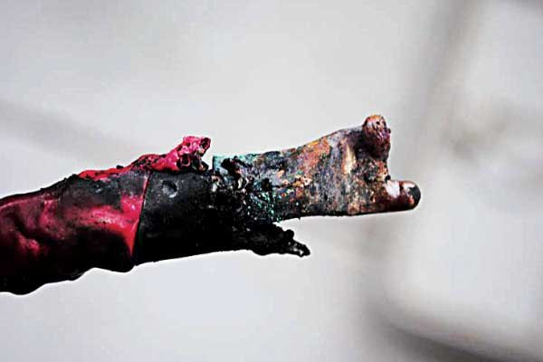 Photo of a charred battery cable connector