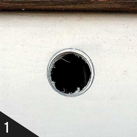 Photo of a drilled hole for USB socket