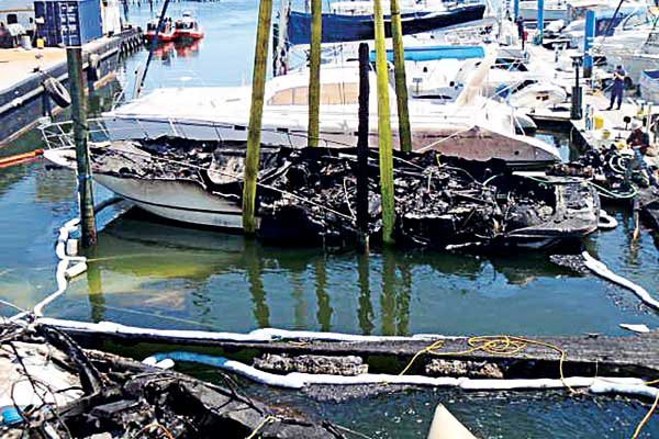 Photo of the aftermath of a marina fire