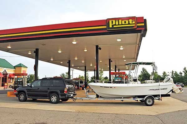 Photo of a trailered boat at a gas station