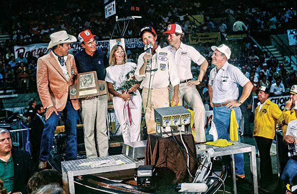 Photo of George Bush, Sr. and Bill Clinton sharing the stage at the Bassmaster Classic in 1984