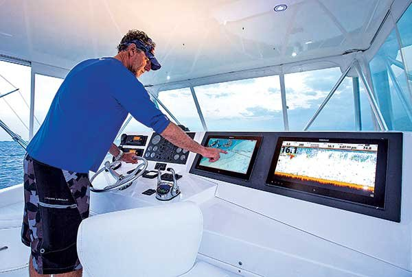 Photo of boater checking his chartplotter