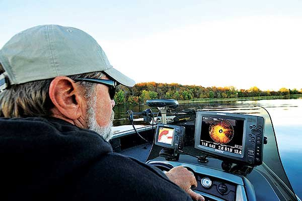Photo of a man using a fish finder