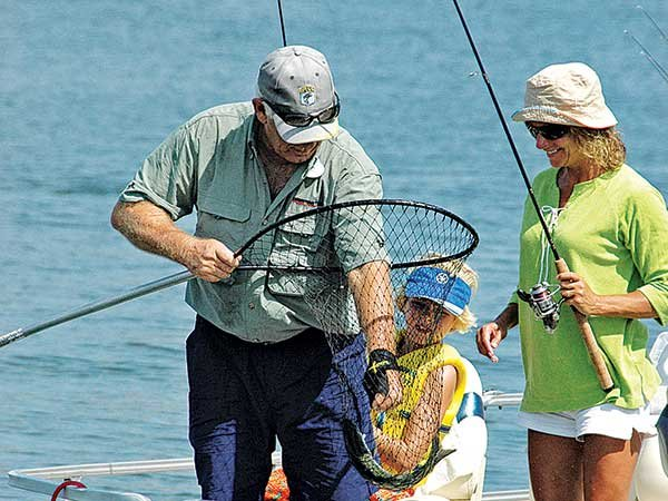 Photo of catching a fish in a landing net