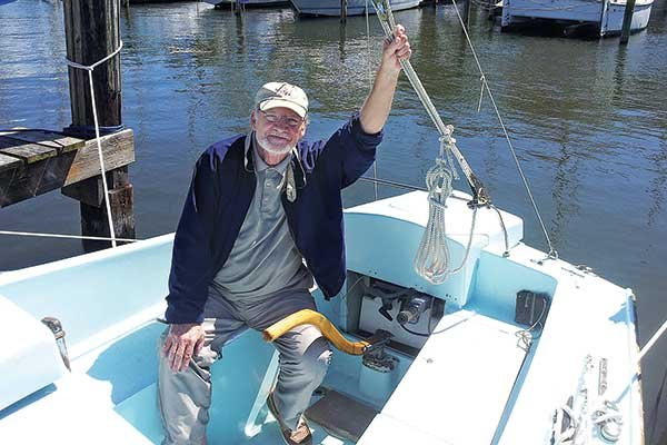 Photo of Mark Vance, aboard his 27-foot Snapdragon sailboat