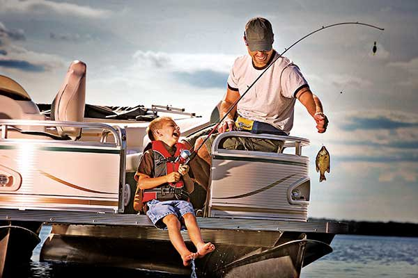 Photo of a family fishing on a pontoon boat