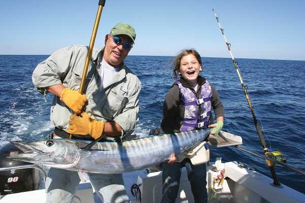 Photo of Mollie with her first wahoo catch