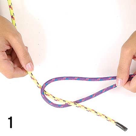 Photo of tying a sheet bend knot step 1