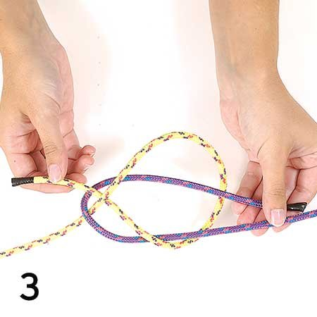 Photo of tying a sheet bend knot step 3