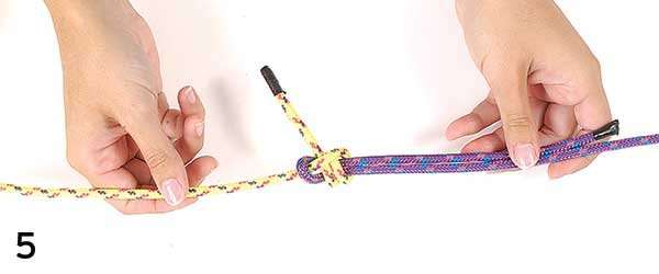 Photo of tying a sheet bend knot step 5