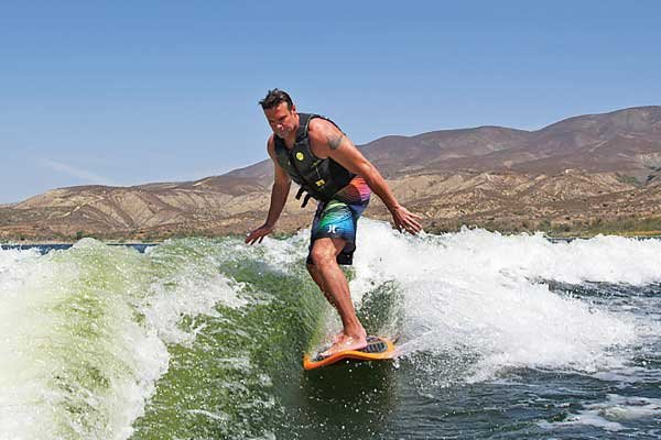 Photo of Troy Gentry wakesurfing behind his boat