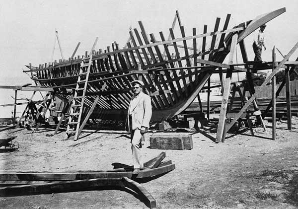 Jack London in front of ship frame