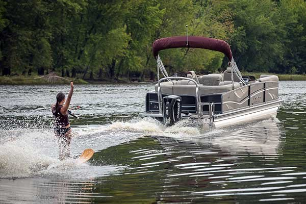 Premier Encounter 310 pontoon boat towing waterskier