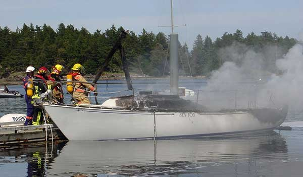 Firemen putting out a boat fire