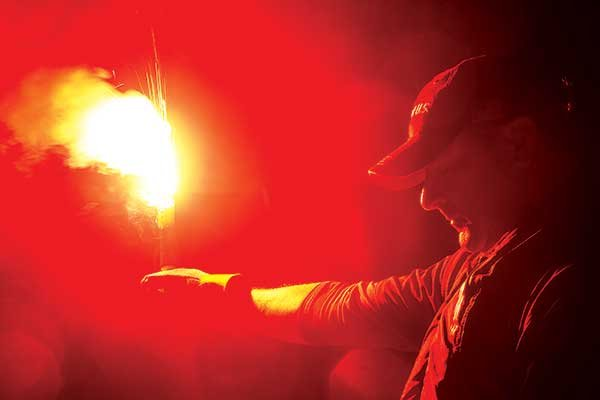 Holding a burning flare
