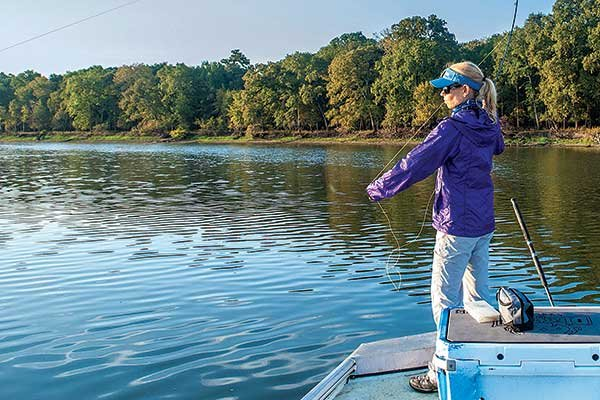 Debbie Hanson on Oxbow Lake fly casting