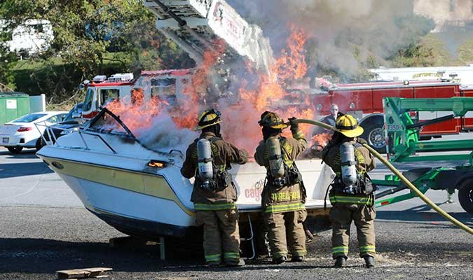 Firefighters putting out boat fire