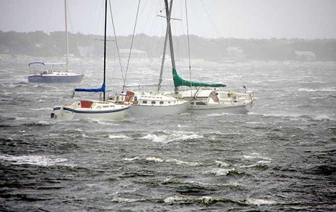 Boats moored in a storm
