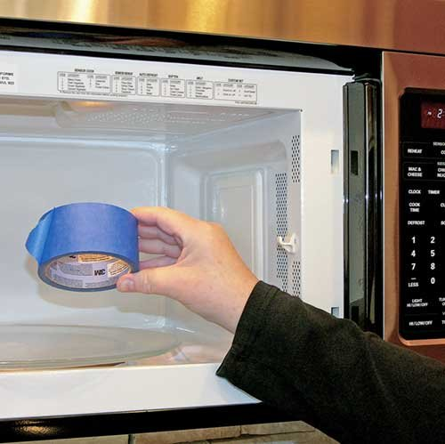Putting masking tape in a microwave