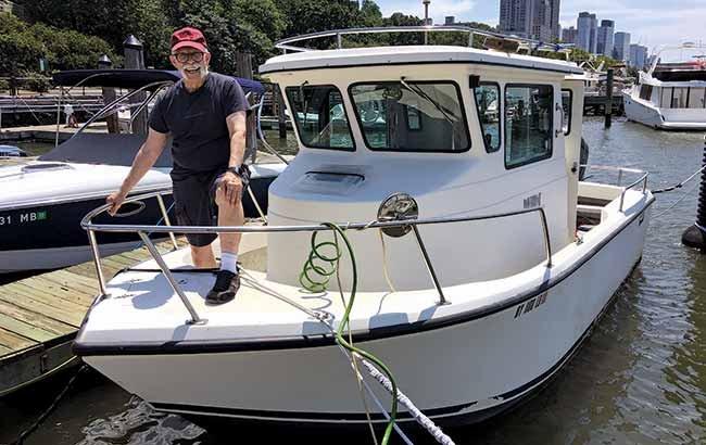 Dick DeBartolo aboard his pilothouse powerboat