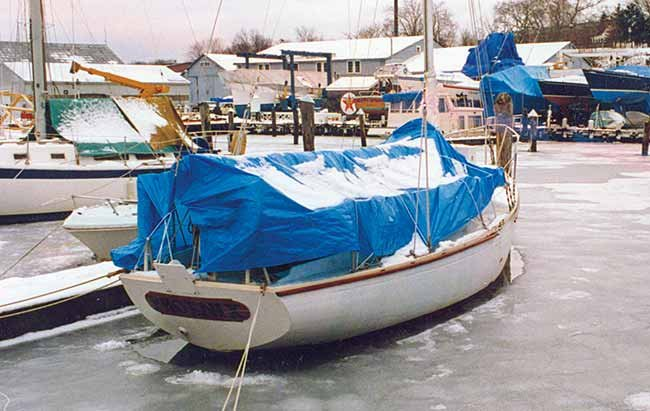 Sailboat docked for winter