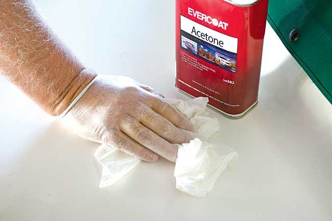 Wiping down surface with acetone