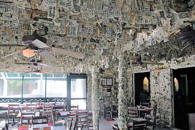 Dollar bills line nearly every surface of the restaurant on Cabbage Key