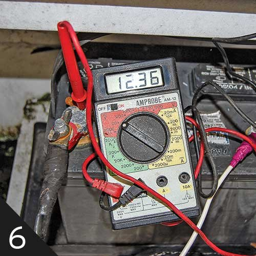 Using a voltmeter to check battery