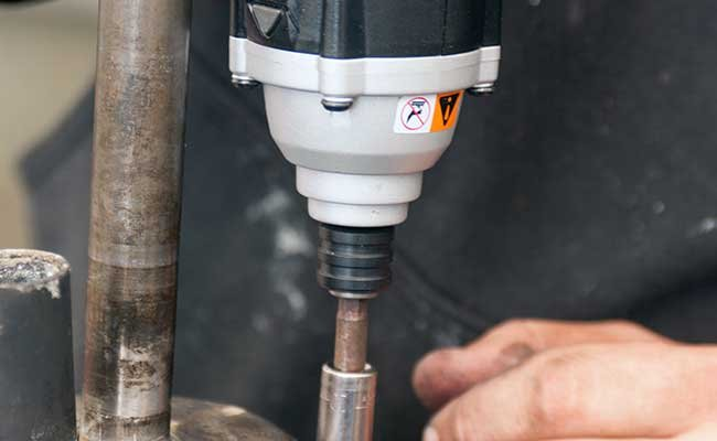 Using an impact wrench