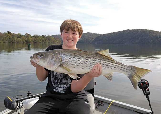 Young boy with large stripper catch