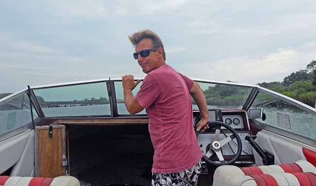 Captain Jack at helm of his boat