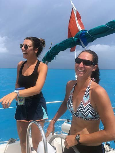 Emily and Grace racing in the George Town regatta Around-the-Island race