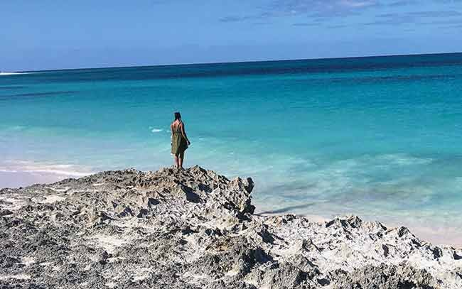 Grace looks out on the ocean from Hopetown in the Abacos