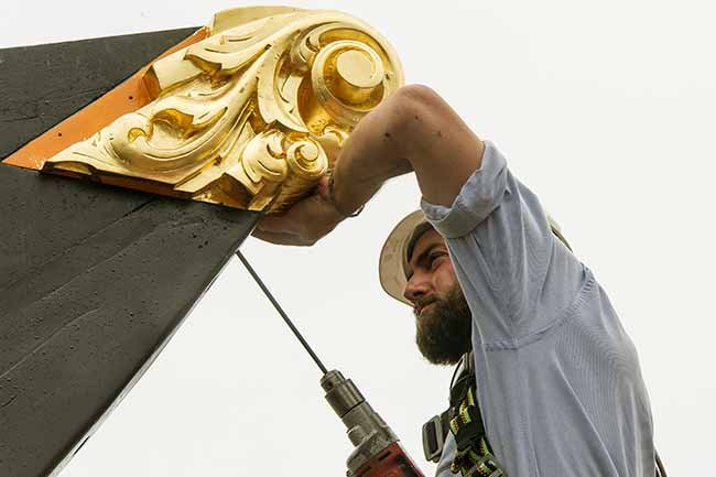Shipwright Matt Barnes installs the billet head on Charles W. Morgan