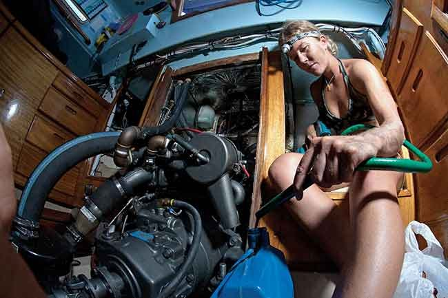Liz Clark doing an oil change on Swell