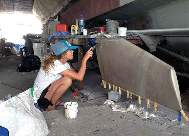 Liz Clark making a rudder repair