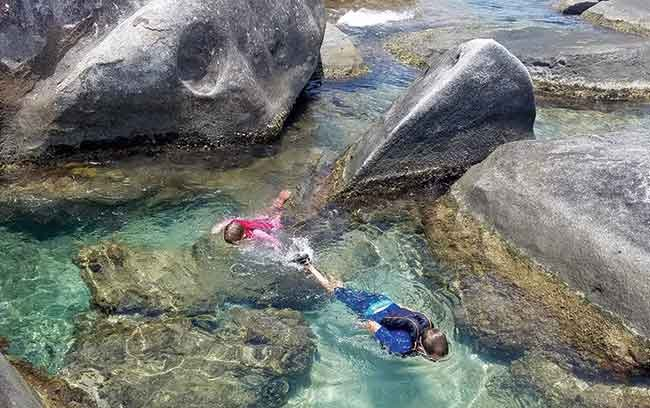 Exploring the warm rock pools at The Baths in Virgin Gorda