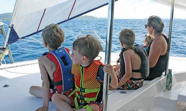 Family on a 48-foot catamaran in the British Virgin Islands