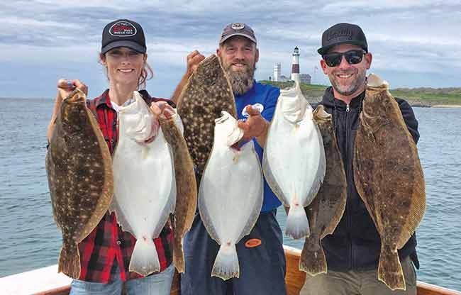 Charter fishing trip group fluke catch