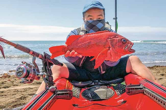 Nhia Vang shows off vermillion rockfish catch