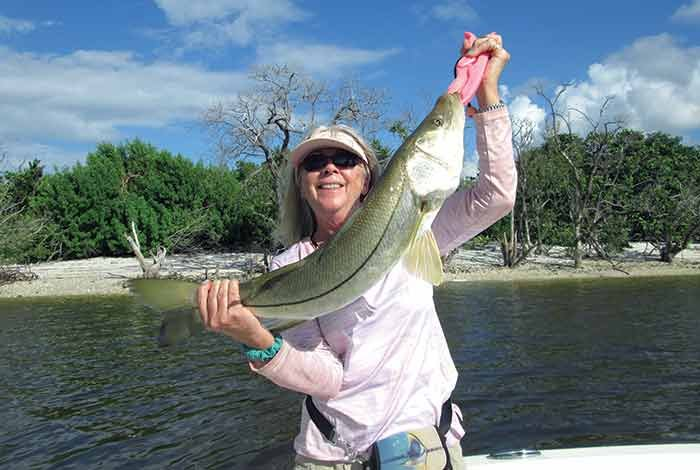 Betty Bauman with 32-inch snook