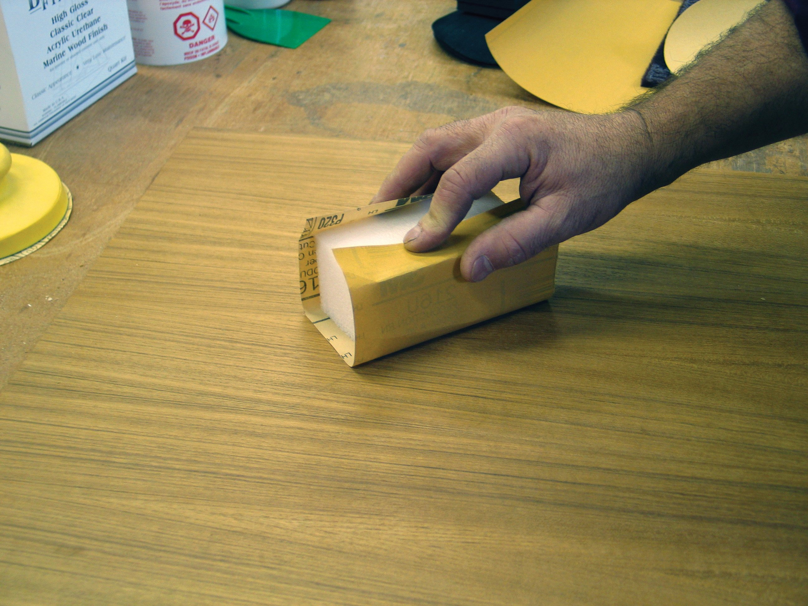Photo of sanding the wood surface
