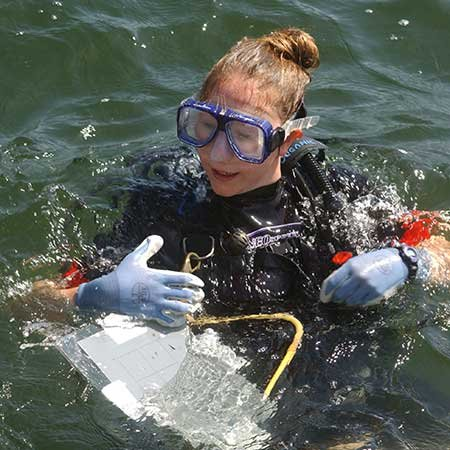 Photo of an archaeology student diving a shipwreck