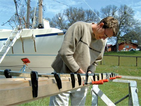 Photo of Ben showing off his boatbuilding skills