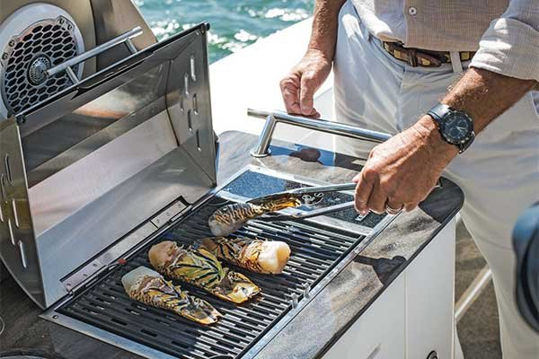Photo of grilling chicken on your boat