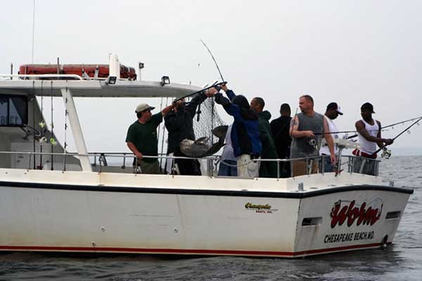 Photo of guys fishing charter