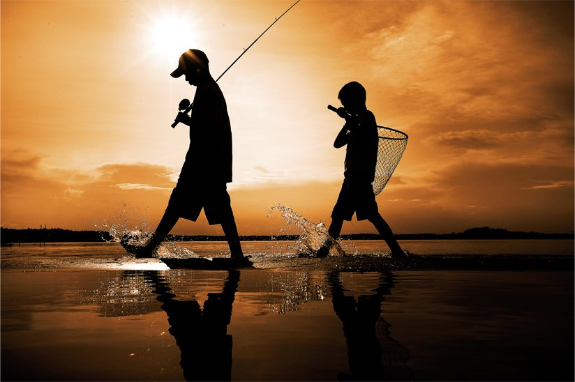 Photo of silhouette of two boys going fishing