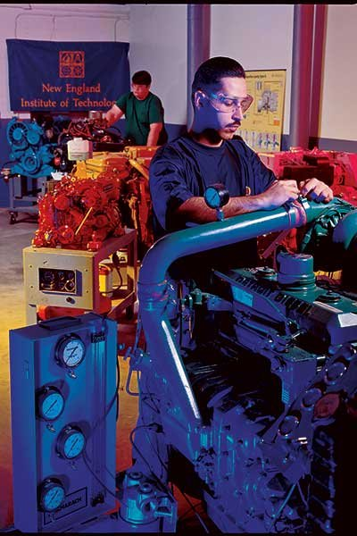 Photo of student in engine class