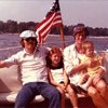Thumbnail photo of John and John West on their boat in 1973